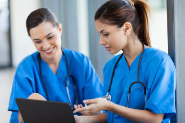 healthcare workers using laptop